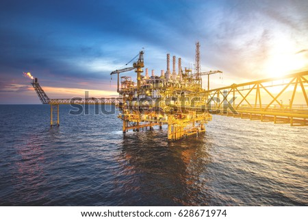 Industrial Offshore oil and gas rig platform with beautiful sky