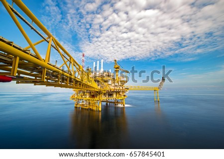 Industrial Offshore oil and gas rig platform with beautiful sky in the gulf of Thailand.