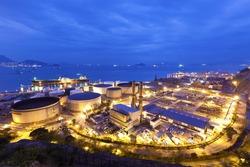 Industrial oil tanks at night