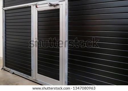 Industrial overhead sectional doors. Sectional garage doors. Garage. Entry to production. Gate with a door. #1347080963
