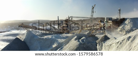 Industrial panorama, industrial constructions and equipment for crushing and grinding stone ore, mining industry. #1579586578