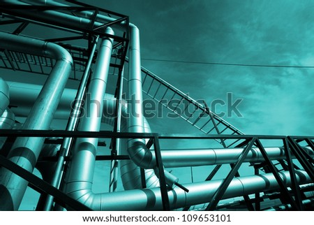 industrial pipelines and valve in blue tones