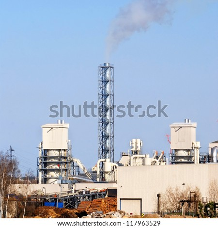industrial plant. Factory with pipes against blue sky