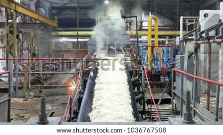 Industrial premises sugar factory. Sugar refinery. Industrial buildings exterior, production of sugar from sugar beets