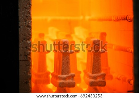 Industrial pressing equipment. Metallurgical business. A huge furnace for heating steel. Insides of a roasting oven. #692430253