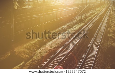 Industrial Railway with freight cars at sunset. Hipster toning ストックフォト ©