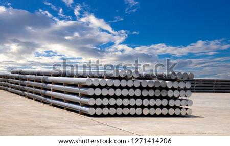 industrial raw materials, heap of aluminium bar in aluminium profiles factory. #1271414206