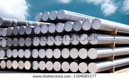 Industrial raw materials, Heap of aluminium bar in aluminum profiles factory.  #1104085577