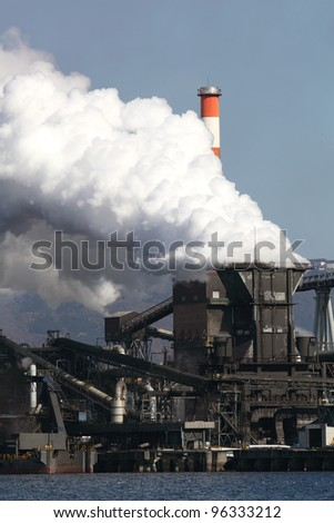 Industrial refinery plant with smoke