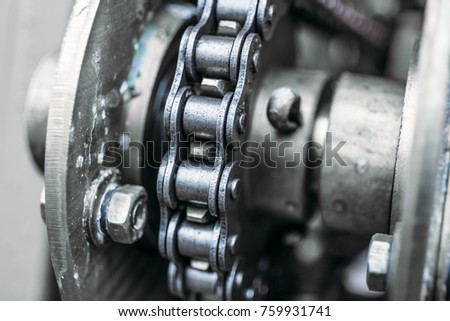 Industrial roller chain, macro photo close up, technology background, toned