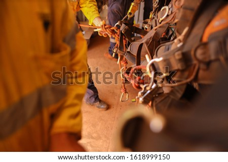 Industrial rope access technician inspector double checking inspecting figure of eight knot 10.5 mm static rope call as cawtails after tie into abseiling safety harness loop prior working of each task