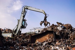 Industrial scrap metal recycling in junkyard.