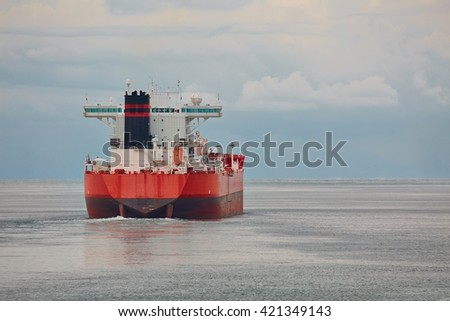 Industrial ship headig out at sea