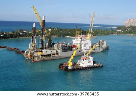 Industrial ship that digs sand making harbor deeper for bigger ships to be able to dock in Nassau port in the Bahamas