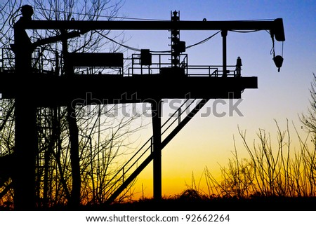 Industrial silhouette at sunset, Louisiana, United States