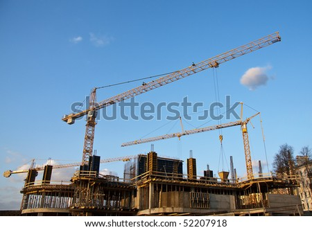 Industrial site with construction cranes