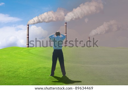 industrial smoke comes out of a chimney  against  the  blue sky