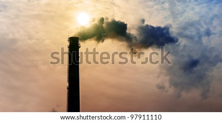 industrial smoke from chimney on sky