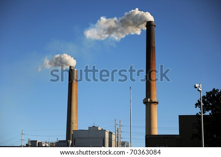 Industrial smokestacks releasing smoke into the environment