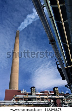Industrial Stack at Nickel Plant with blue sky as background
