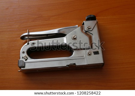 Industrial stapler is on the table