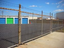 industrial storage with rusted fence and colorful doors