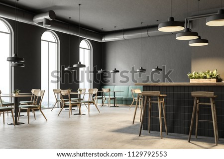 Industrial style bar corner with dark gray walls, a concrete floor, arched windows and wooden tables with chairs. Green sofas. 3d rendering mock up