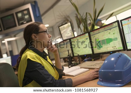 Industrial technician working in monitoring control room
