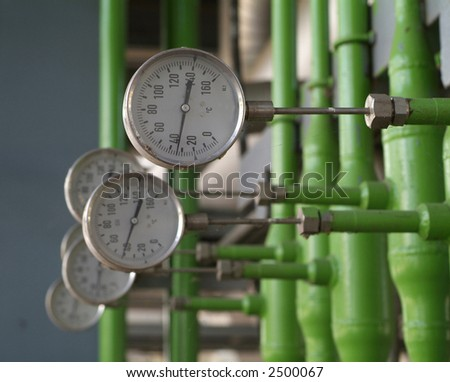 Industrial temperature meters for liquids. Shallow depth of field.
