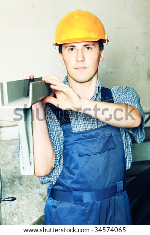 Industrial theme: a worker at a manufacturing area.