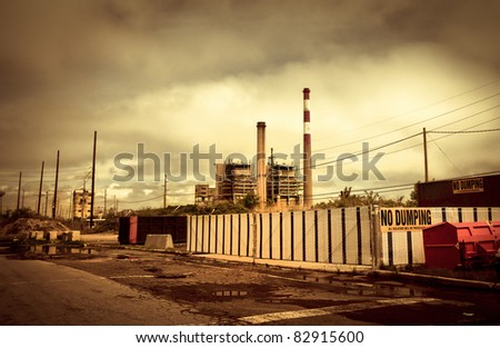 Industrial, toxic landscape of abandoned smoke stacks and waste removal plant