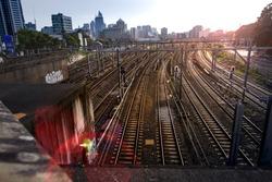 Industrial trains railway yard against urban city skyline