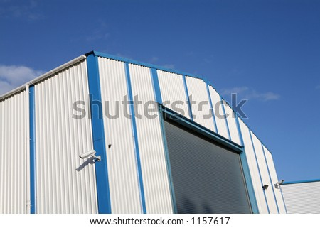 Industrial unit with roller shutter door