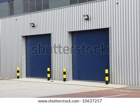 Industrial Unit with steel roller shutter doors - stock photo