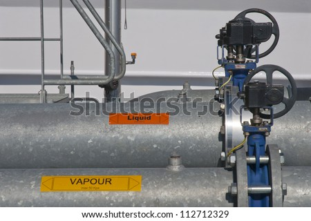 industrial valve for liquid and vapour on board of ship - stock photo