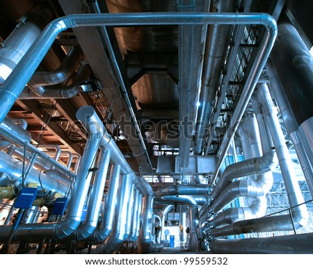 industrial valves and pipes against blue sky
