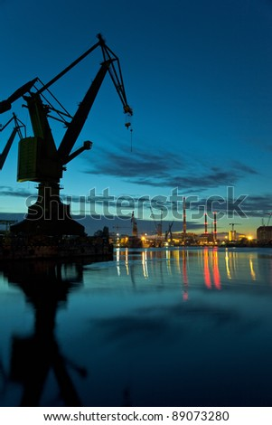 Industrial view at night in shipyard of Gdansk, Poland.