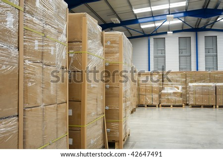 industrial warehouse interior and pallets with cardboard cartons