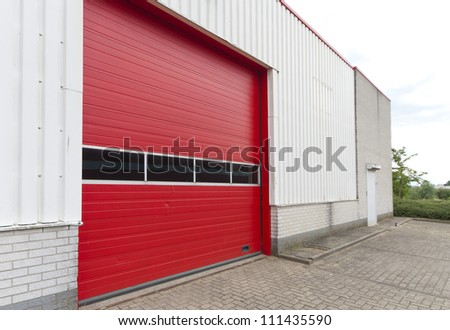 industrial warehouse with red roller door