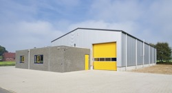 industrial warehouse with yellow roller door