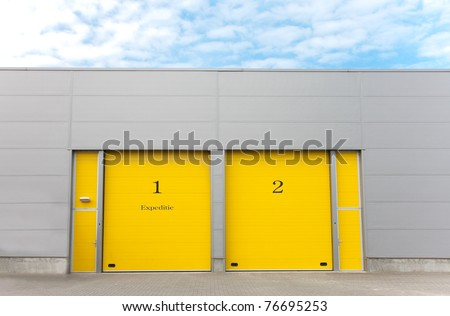 industrial warehouse with yellow roller doors