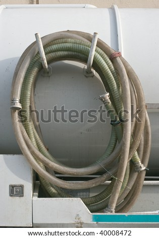 Industrial Waste Removal Pump with Coiled Hose - stock photo