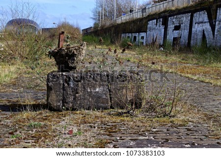 Industrial wasteland with old bit of concrete that looks like a sculpture