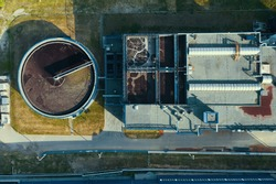 Industrial wastewater cleaning in round storage. Sewage treatment plant, aerial top view.