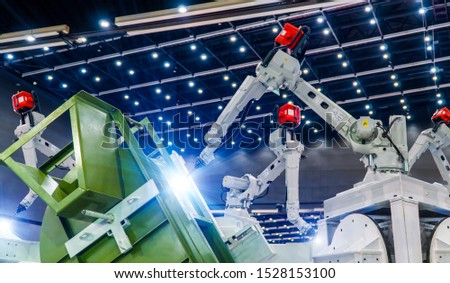 Industrial welding robots in production line manufacturer factory