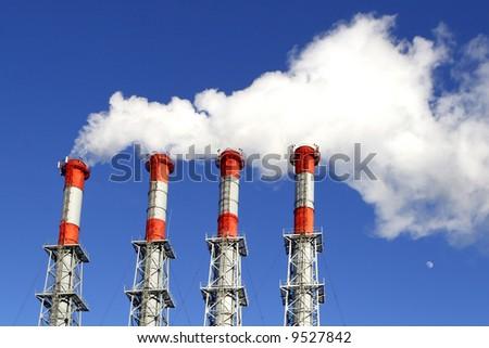 industrial white smoke on blue sky