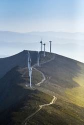 industrial wind mill instalation in top of a hill