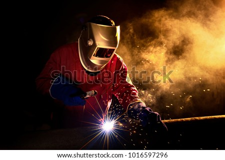 Industrial Worker at the factory welding closeup Stock photo ©