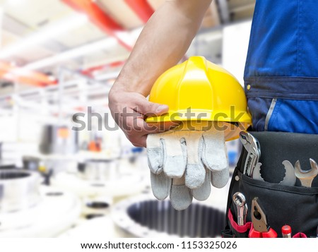 industrial worker for assembly in a plant, workplace with work clothes
