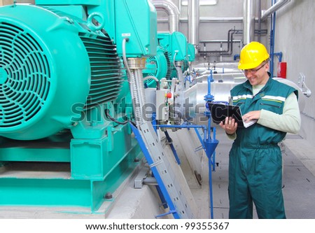 Industrial worker with notebook, happy and satisfied - stock photo
